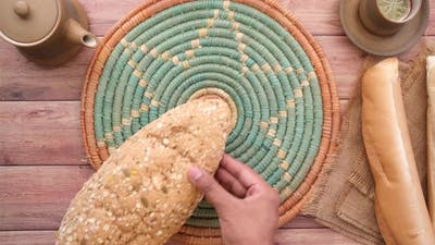 Putting Whole Meal Bread on Table