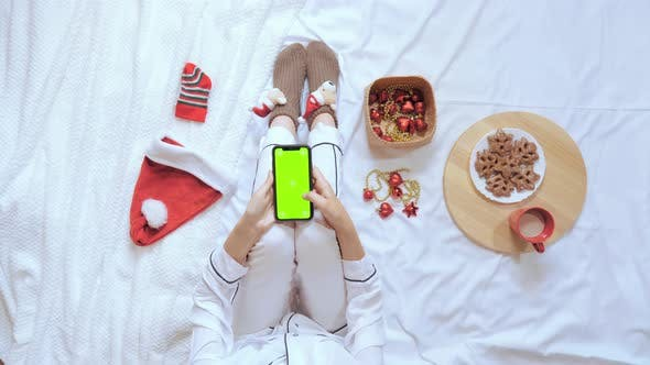 Thumbnail for Top View Female Use Smartphone in Bedroom Christmas Eve
