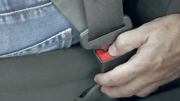 Thumbnail for Male Hand Unfastening Car Safety Seat Belt