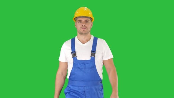 Thumbnail for Walking worker in yellow helmet on a Green Screen, Chroma Key.