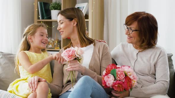 Cover Image for Family Greeting Mother with Flowers at Home