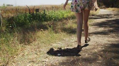Wanderlust white girl walking an isolated dirt road