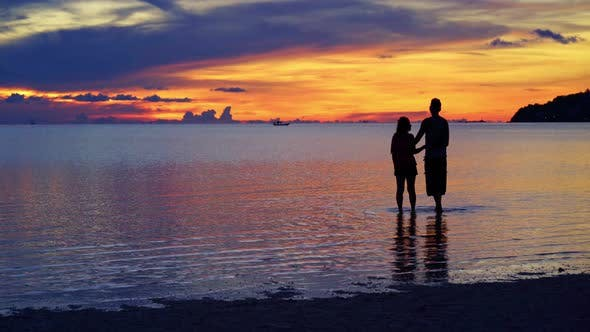 Thumbnail for Couple Enjoy Sunset on the Beach at Sunset