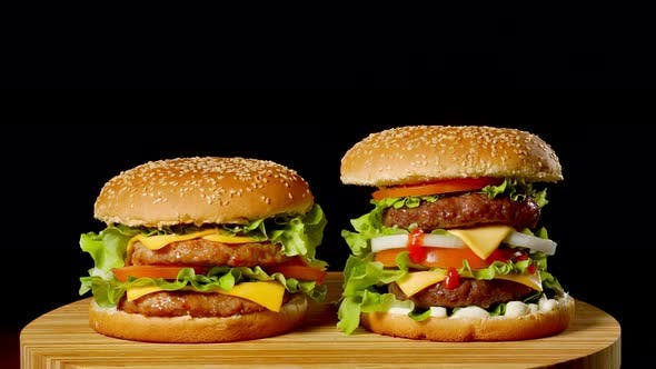 Thumbnail for The Concept of American Fast Food. Juicy American Burger with Two Beef Cutlets, with Sauce and