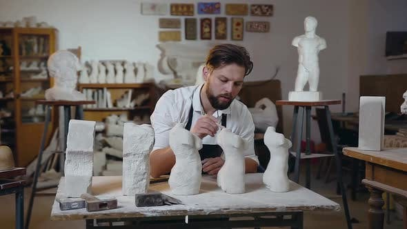 Thumbnail for Sculptor with Beard which Sitting at His Workplace