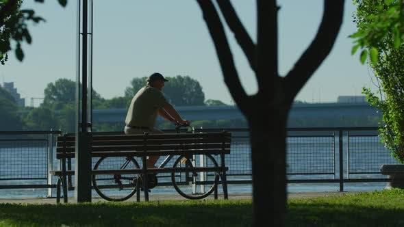 Thumbnail for Riding bikes along the riverside