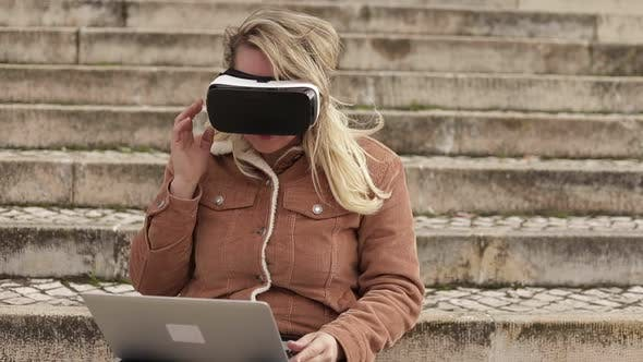 Thumbnail for Slow Motion Shot of Young Woman with VR Glasses and Laptop