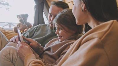 Parents and Daughter Using Tablet