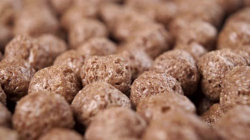 Crunchy chocolate cereal. Textured flakes balls