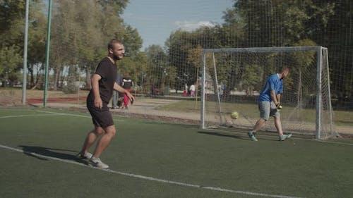 Soccer Player Scoring a Goal After Penalty Kick