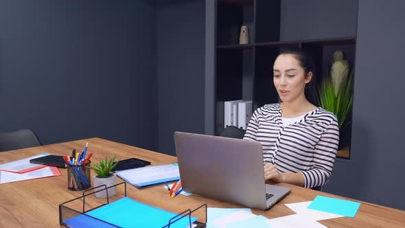 Thumbnail for Woman Has a Video Call Using Her Laptop