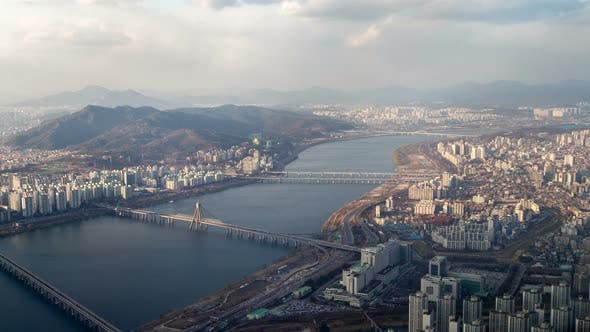 Thumbnail for Timelapse Large Winding River Flows Between Seoul Districts