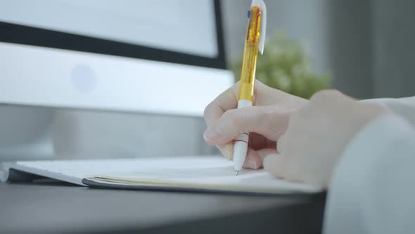 Thumbnail for Woman Writing In Office