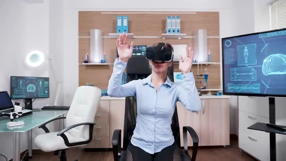 Cover Image for Female Scientist in a Research Laboratory Using Virtual Reality Goggles