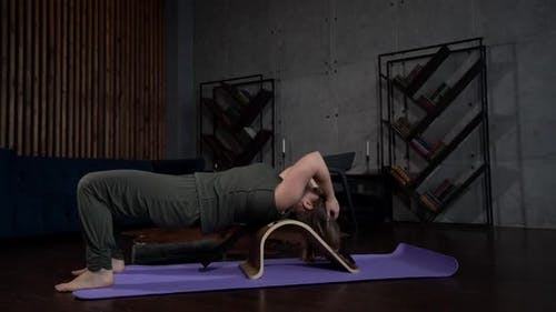 The Training in Yoga. an Adult Woman and Does Exercises To Restore the Back. the Concept of a