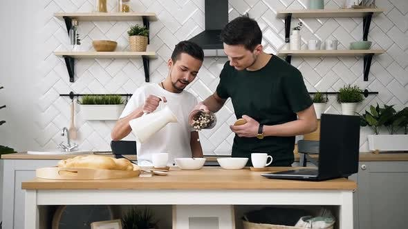Thumbnail for Gay Couple Preparing Breakfast in Kitchen at Morning