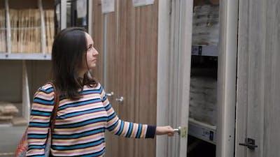 Woman Choosing Interroom Doors for Home in Store