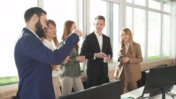 Group of Young Managers Communicating During Meeting