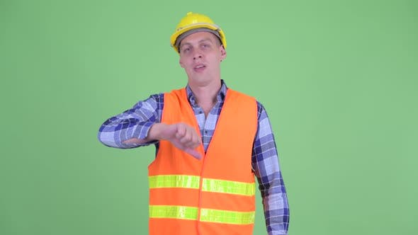 Thumbnail for Angry Young Man Construction Worker Giving Thumbs Down