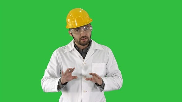 Thumbnail for Confident Engineer Man Talking Camera on a Green Screen
