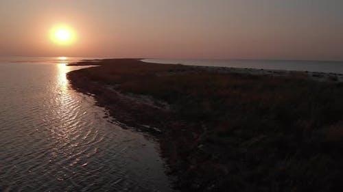 Beautiful Sunset at the Waving Sea