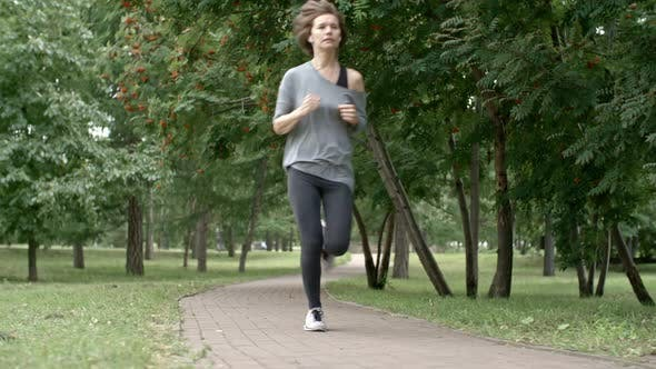 Thumbnail for Young Woman Running in Park