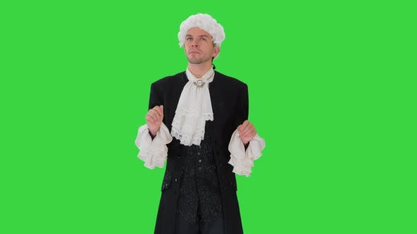 Thumbnail for Man Dressed in Courtier Frock Coat and White Wig Thinking and Fidgeting with His Fingers on a Green