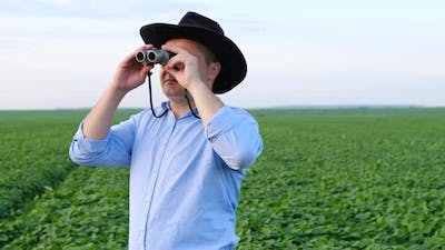 Travel Guide with Binoculars in His Hands