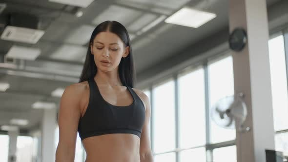 Thumbnail for Attractive Woman Training with Barbell in the Gym Portrait Sport Hand
