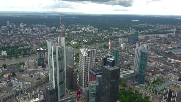 Thumbnail for AERIAL: Spectacular View Over Frankfurt Am Main, Germany Skyline Skyscraper Roofs on Cloudy Overcast