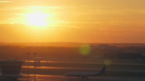 Thumbnail for - Airport View with Moving Plane at Golden Sunset