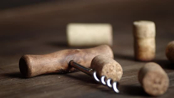 Bottle Corks Fall on the Table with Corkscrew
