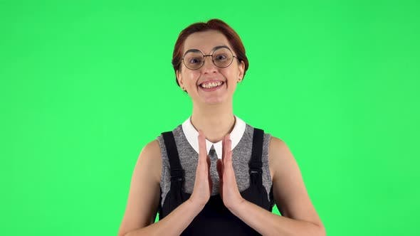 Thumbnail for Portrait of Funny Girl in Round Glasses Is Looking with Tenderness with Folded Arms in Front