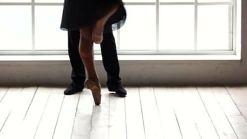 Ballerina Dancing on Toes with Her Partner