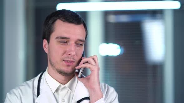 Doctor Speaks On Smartphone In Hospital