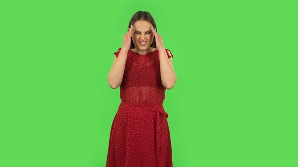 Thumbnail for Tender Girl in Red Dress Is Suffering From Headache From Fatigue. Green Screen