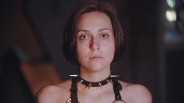 BDSM Concept - Young Woman in Black Spiked Collar