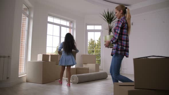 Cover Image for Happy Family Carrying Boxes Moving in New House