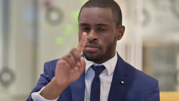 Thumbnail for Portrait of African Businessman Saying No By Finger
