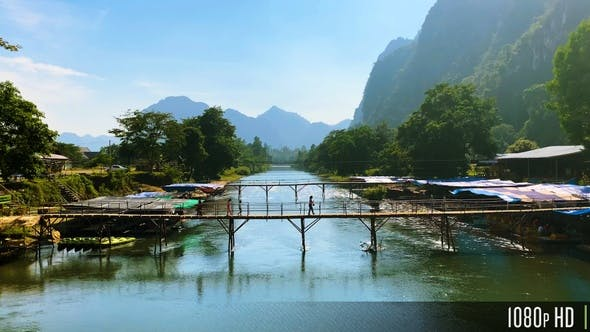 Thumbnail for People Walking Across a Bamboo Bridge in the Mountainous Countryside of Vang Vieng, Laos
