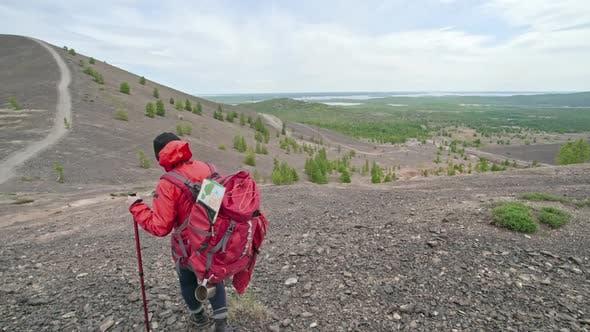 Thumbnail for Female Trekker Walking Down Stony Hill