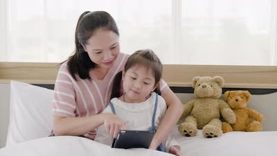 Mother and daughter watching tablet (1)