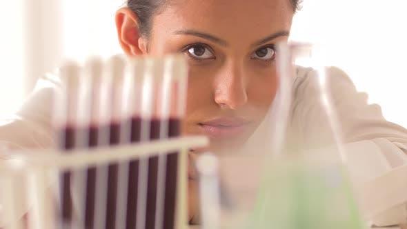 Thumbnail for Hispanic scientist lying on her desk