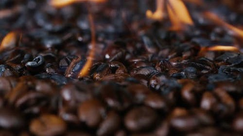 Roasted Black Coffee, Professional Roasting of Beans. Close-up, Preparation of Coffee Beans.