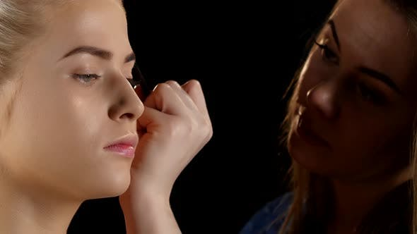 Thumbnail for Cosmetic Beauty Procedures and Makeover Concept. Makeup. Black. Closeup