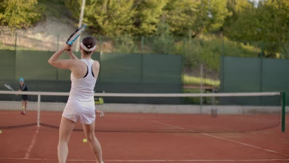 Thumbnail for Woman Tennis Player Practicing Hitting the Ball with the Coach, Hitting the Ball with a Racket