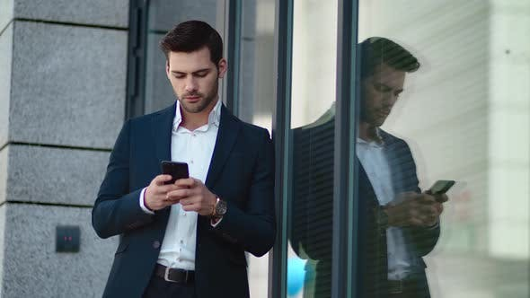 Thumbnail for Closeup Man Standing with Phone Outside. Businessman Using Smartphone at Street