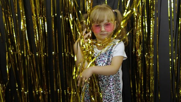 Thumbnail for Happy Child Dancing, Playing, Fooling Around in Shiny Foil Fringe Golden Curtain. Little Blonde Girl