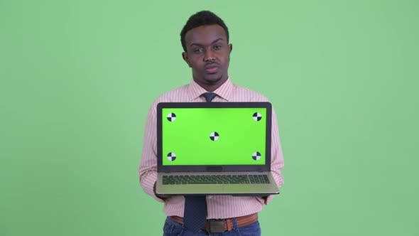 Cover Image for Stressed Young African Businessman Showing Laptop