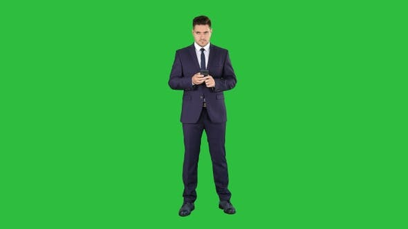 Thumbnail for Businessman texting message on the phone on a Green Screen